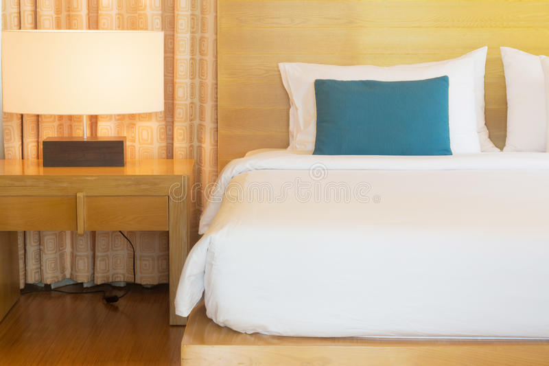 Wood bed. Large wood bed with white duvet stock photos