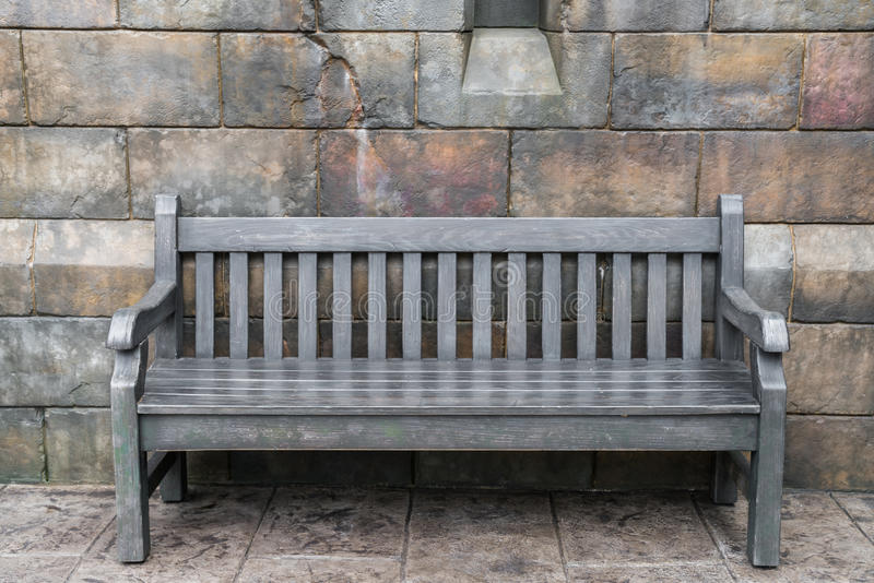Wood Bench against concrete wall . royalty free stock photo