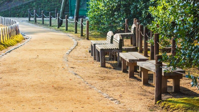 Wood benches and chairs at Koraku-en stock photography