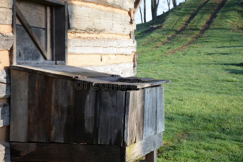 Wood Bin. Built on the side of a log cabin to keep the wood dry for later use royalty free stock photos