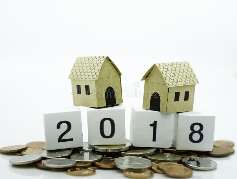 2018 wood block on the coins with the house use for new year fin stock photography