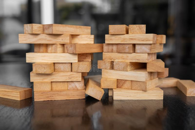Wood block pile with architecture model with classic black tone background, Concept Risk management and strategy plan, growth. Business success process and team royalty free stock photo