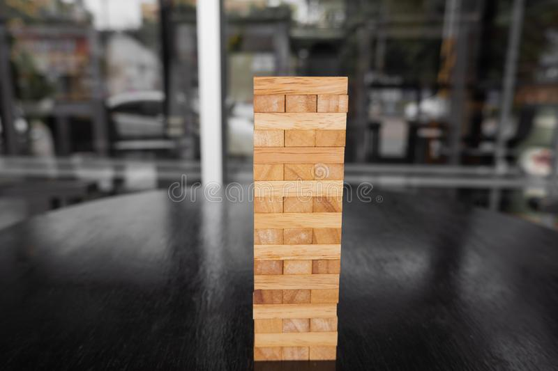 Wood block pile with architecture model with classic black tone background, Concept Risk management and strategy plan, growth. Business success process and team stock image