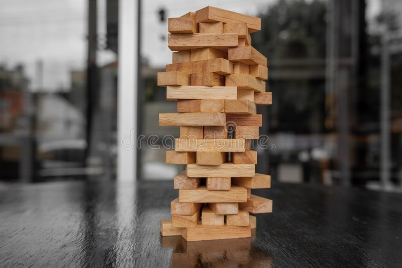 Wood block pile with architecture model with classic black tone background, Concept Risk management and strategy plan, growth. Business success process and team royalty free stock images