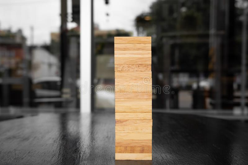 Wood block pile with architecture model with classic black tone background, Concept Risk management and strategy plan, growth. Business success process and team royalty free stock image