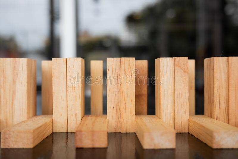 Wood block pile with architecture model with classic black tone background, Concept Risk management and strategy plan. Wood block pile with architecture model royalty free stock photo