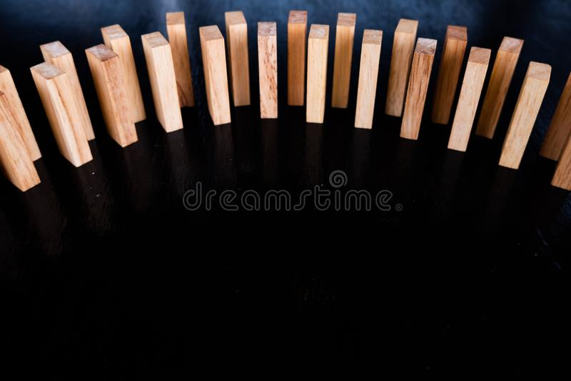 Wood block pile with architecture model with classic black tone background, Concept Risk management and strategy plan. Growth business success process and team stock photo