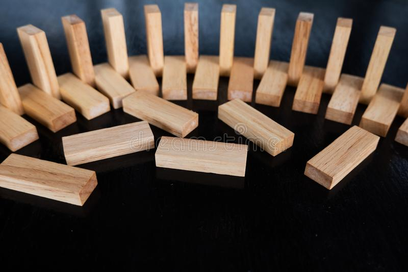 Wood block pile with architecture model with classic black tone background, Concept Risk management and strategy plan. Growth business success process and team royalty free stock images