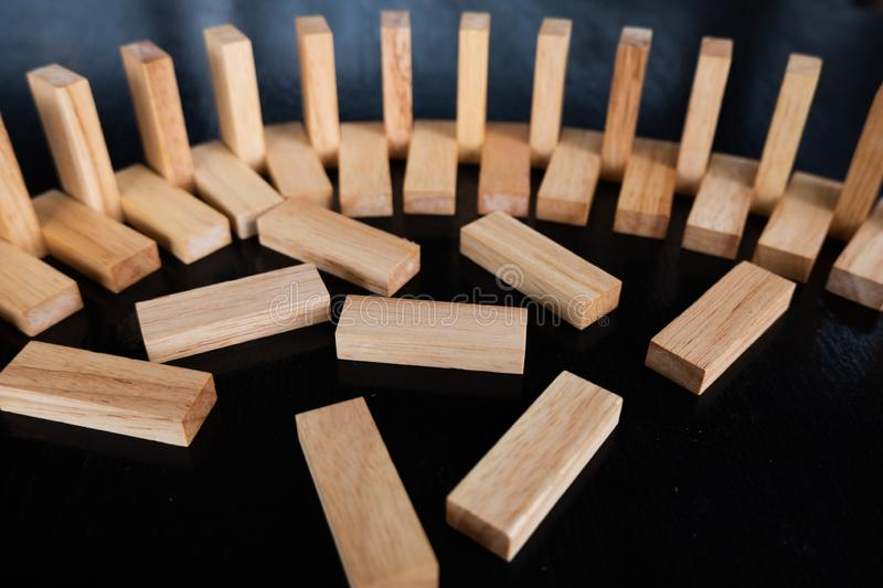 Wood block pile with architecture model with classic black tone background, Concept Risk management and strategy plan. Growth business success process and team stock photography