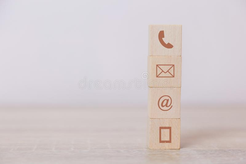 Wood block symbol telephone, address,mail and mobile phone.The concept of communication through technology royalty free stock photo