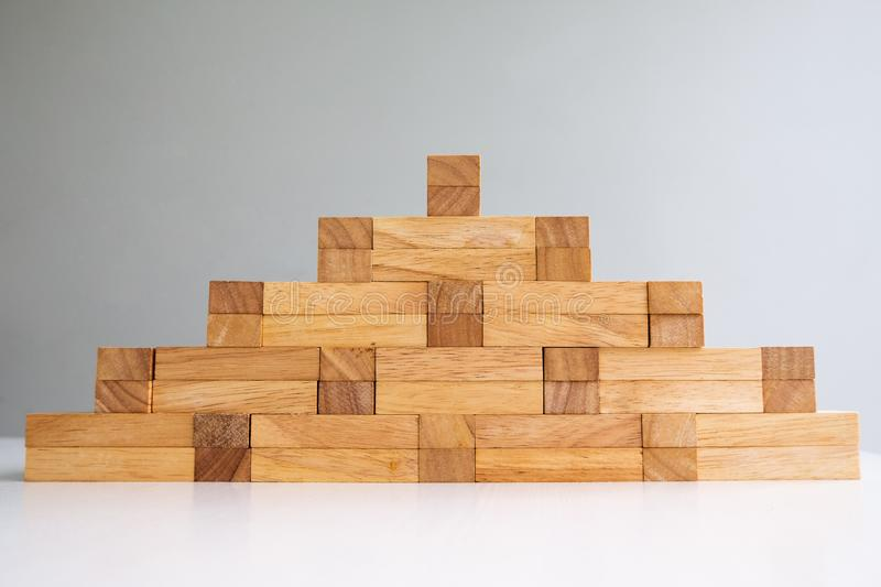 Wood block tower with architecture model, Concept Risk of management and strategy plan, growth business success process. And team work royalty free stock photo