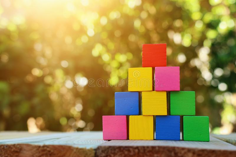 Wood blocks stacking as step stairs. success and development concept.  stock images
