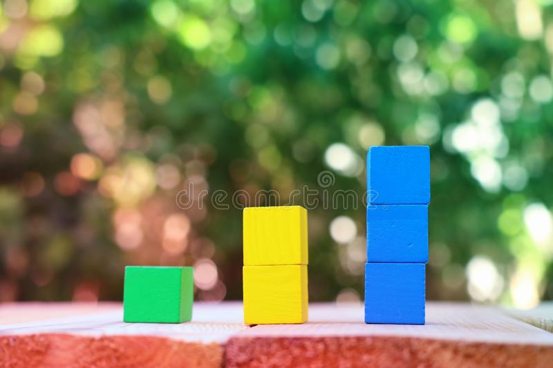Wood blocks stacking as step stairs. success and development concept.  stock photography