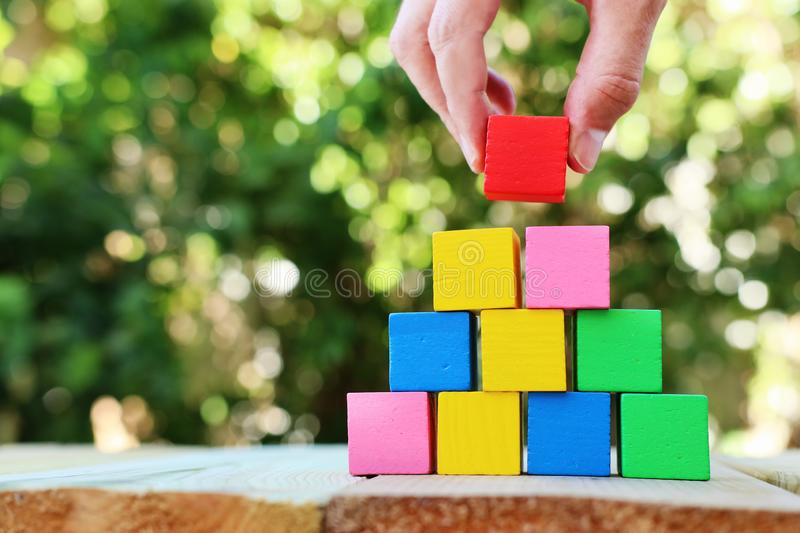 Wood blocks stacking as step stairs. success and development concept.  royalty free stock image