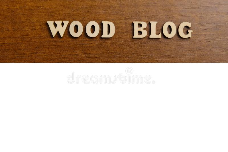 WOOD BLOG. An inscription made of wooden letters against the texture of a dark brown wood. White copyspace. stock photo