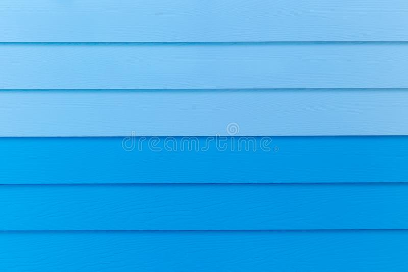 Wood blue background.blue Synthetic wood wall texture use for background.Colorful wooden board painted in blue. royalty free stock photography