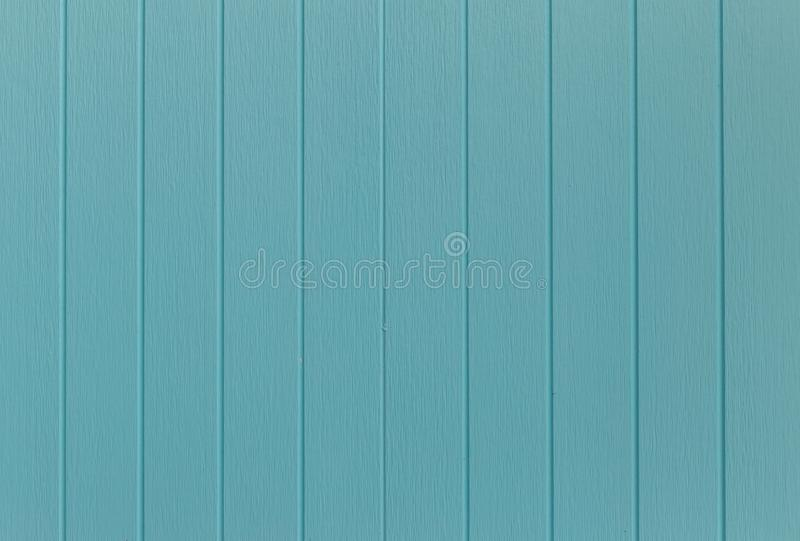 Wood blue background.blue Synthetic wood wall texture use for background.Colorful wooden board painted in blue. Wood background stock photo