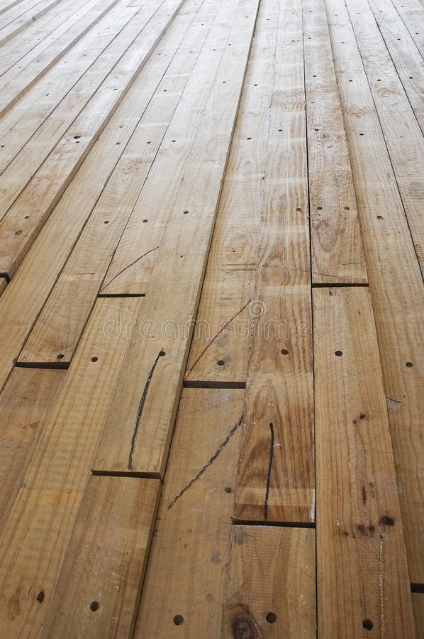 Wood board. Cut and drilled wood board stock image