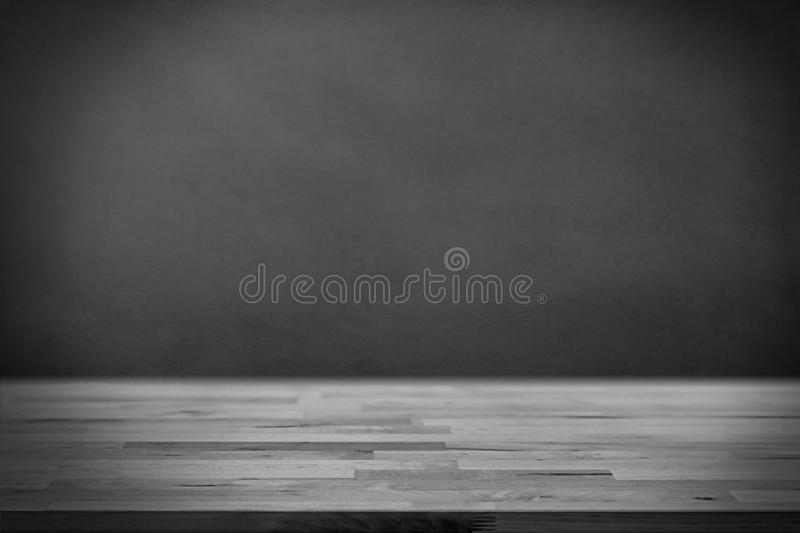 Wood board and dark background. ready for product display.  royalty free stock image
