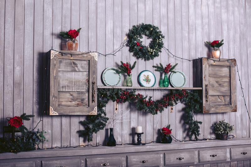 Wood board table in front of Christmas warm gold garland lights on wooden rustic background royalty free stock photos