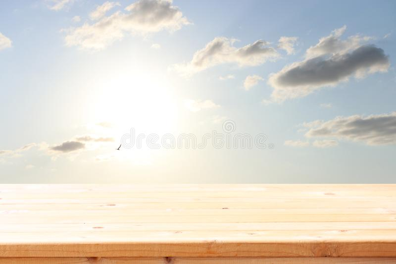 Wood board table in front of blue sky. product display background.  royalty free stock photos