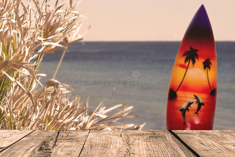 The wood boards on the sea view with plant and surf board stock images