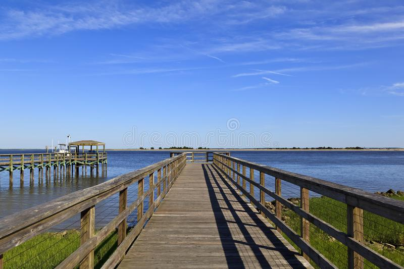 Wood Boardwalk Over the Water. Wood boardwalk at Waterfront Park in Southport, North Carolina in the summer royalty free stock images