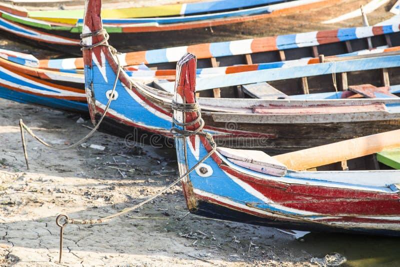 Wood boat Myanmar style at Ubein bridge. Mandalay. Myanmar stock photo