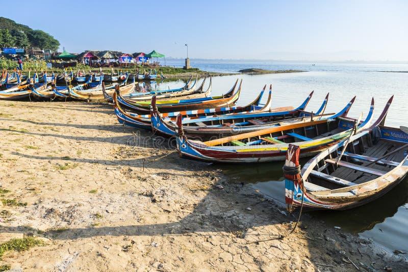 Wood boat Myanmar style at Ubein bridge. Mandalay. Myanmar stock image