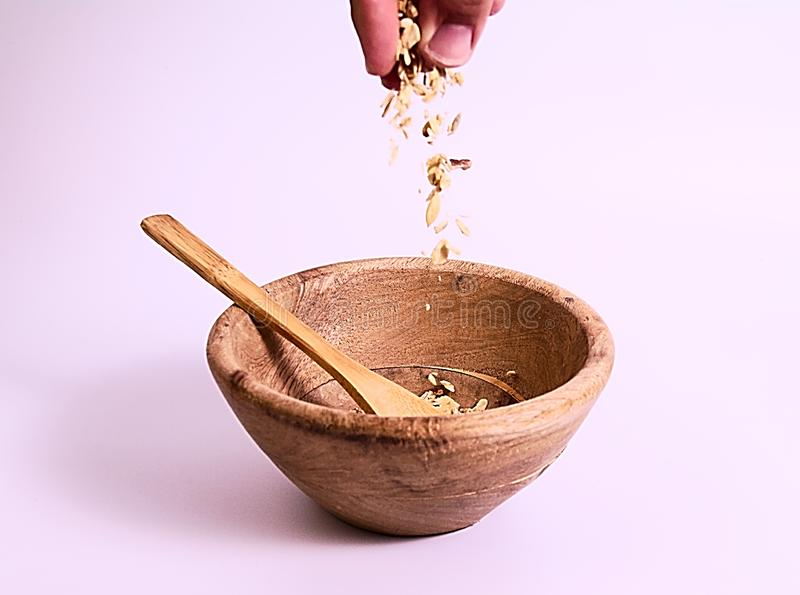 Wood bowl with muesli stock photo