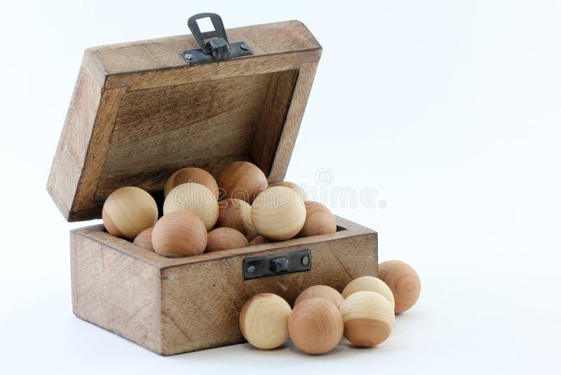 Wood Box and Cedar Balls royalty free stock photography
