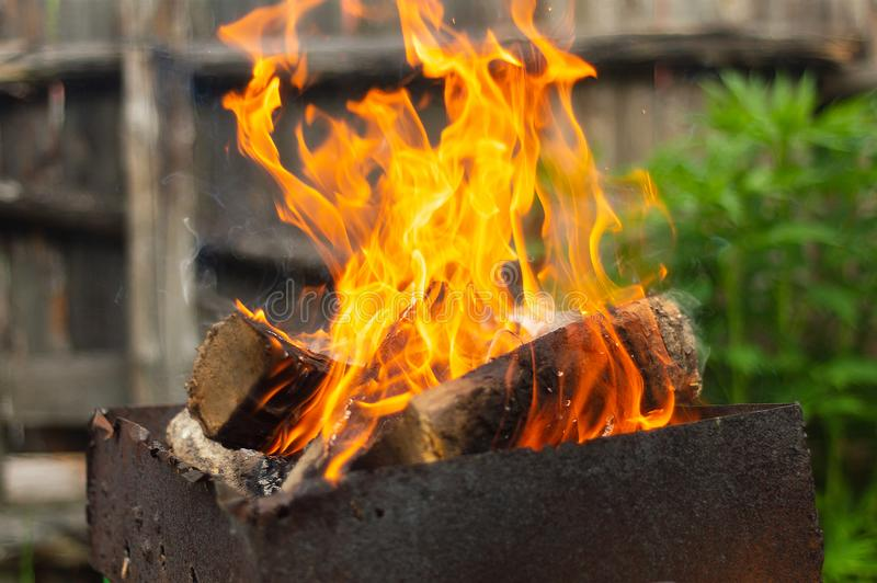 The wood in the brazier, burning a fiery red royalty free stock images