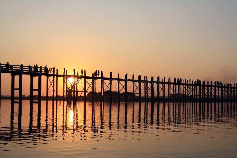 U-Bein wood bridge during sunset stock images
