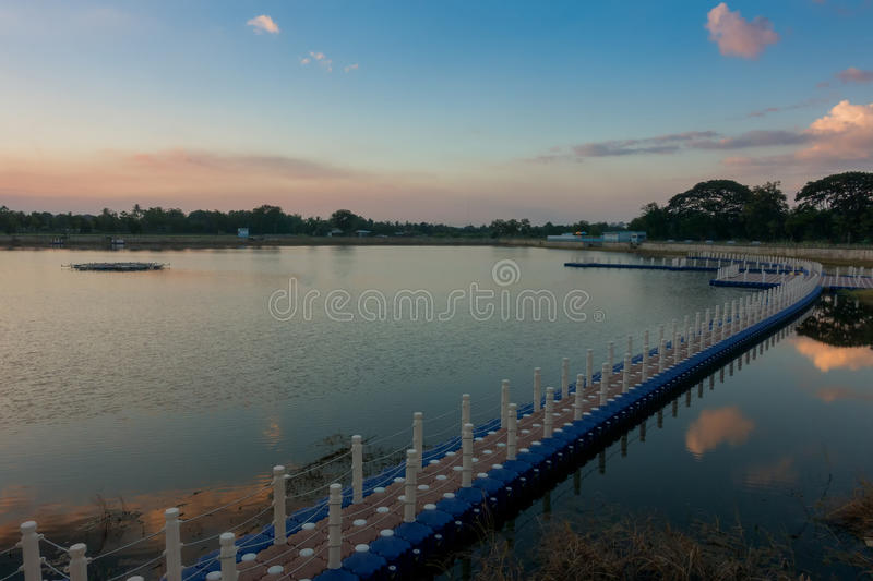 The wood bridge on sunset time in beautiful day stock image
