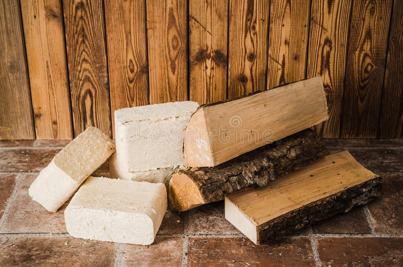 Wood briquette and firewood, close-up. Wood briquette and firewood, close up stock images