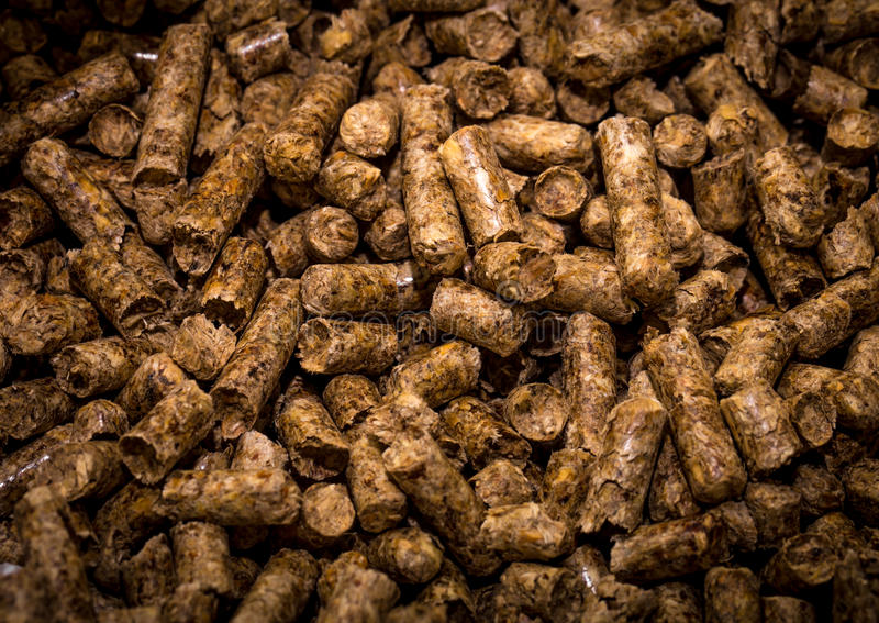 Wood briquettes for solid fuel boilers. Closeup stock photos