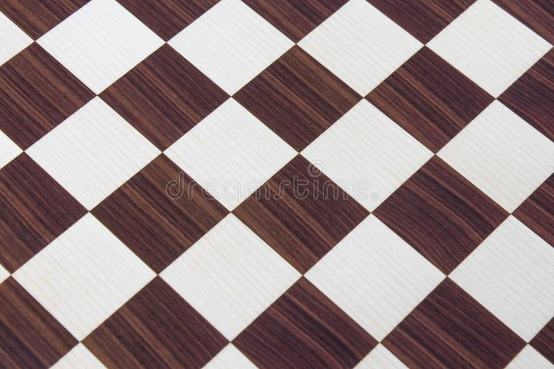 Wood brown chessboard background. Composition stock photos