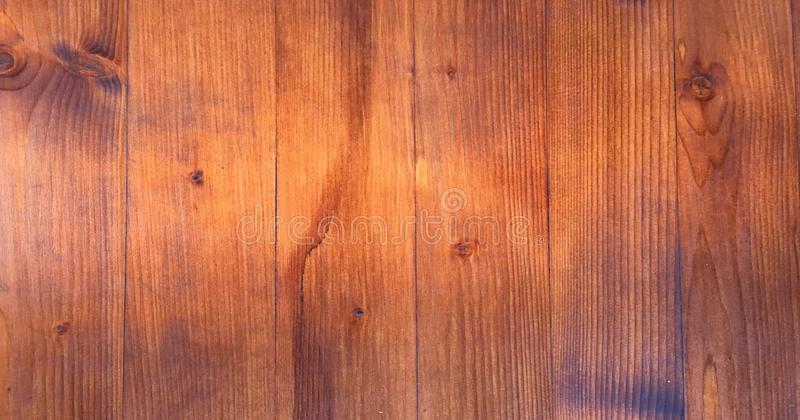 Wood brown grain texture, dark wall background, top view of wooden table. stock images