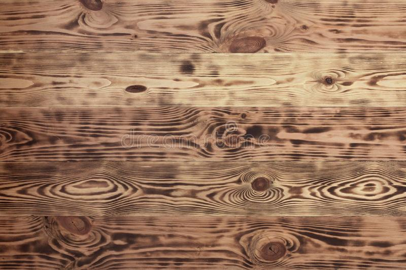 Wood brown oak natural pattern background texture. Vintage style. Abstract background. Retro wooden table.Design background. royalty free stock image