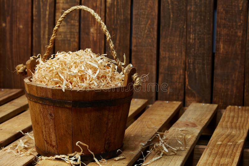 Wood bucket. Full of sawdust stock images
