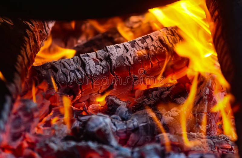 Wood burn with red yellow flame royalty free stock photo