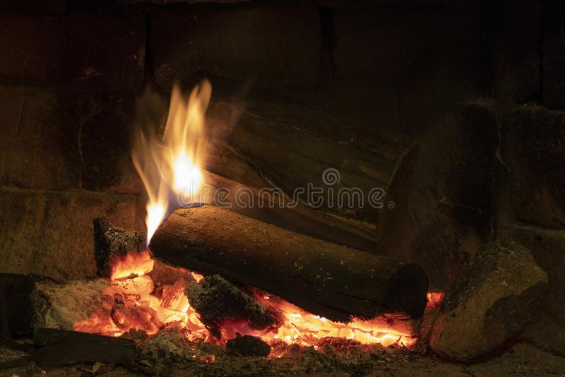 Wood burning in a cozy fireplace at home royalty free stock photo