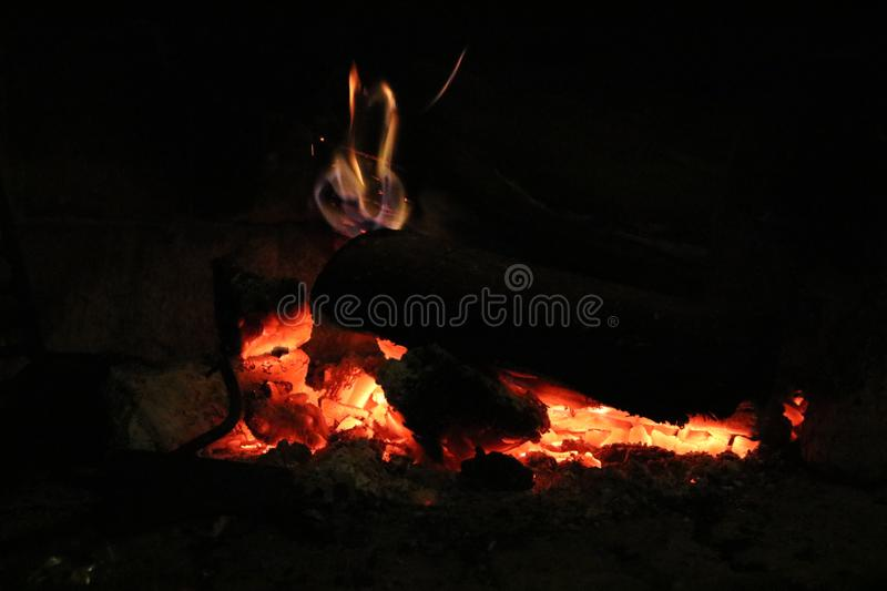 Wood burning in a cozy fireplace at home royalty free stock photos