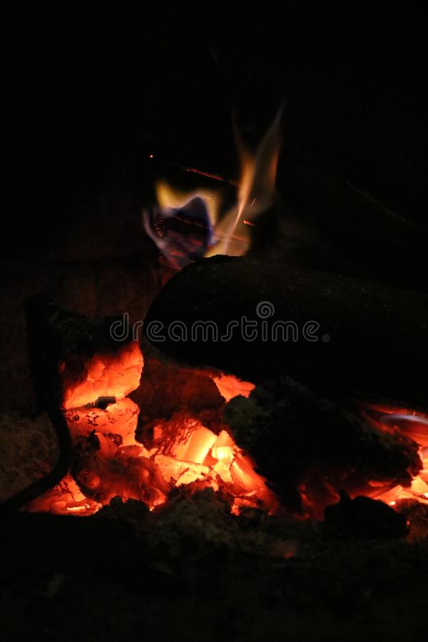 Wood burning in a cozy fireplace at home stock photography