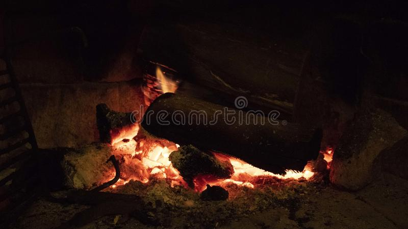 Wood burning in a cozy fireplace at home stock photo