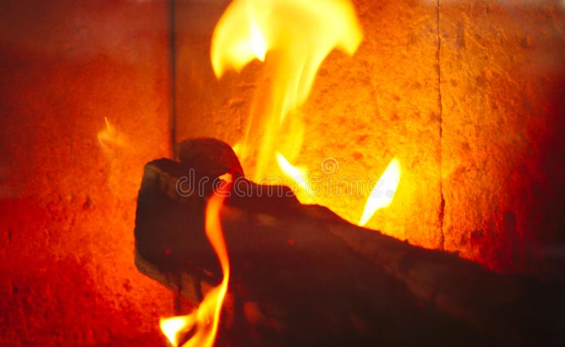 wood burning in a fire place stock image