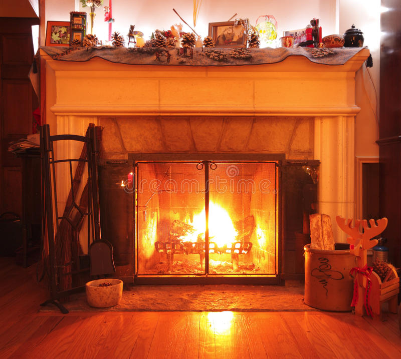 Wood burning fireplace in a living room stock photo