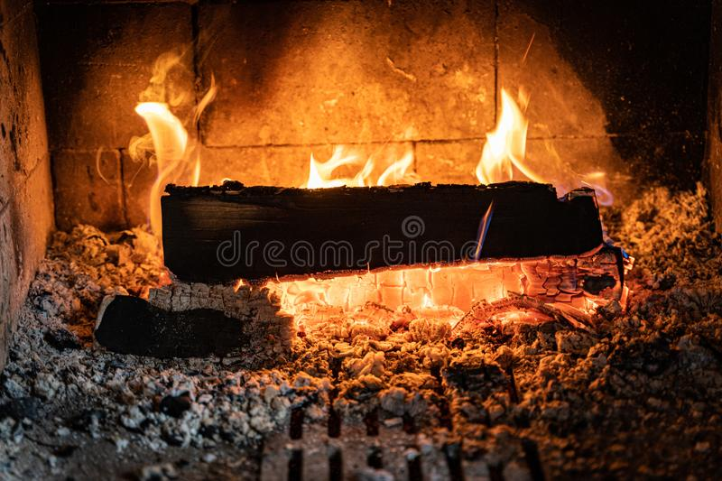 Wood burning inside a fireplace. Fireplace live fire stock image