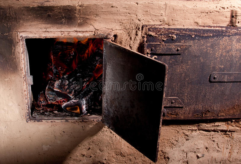 Wood Burning Oven With Fire Stock Photo