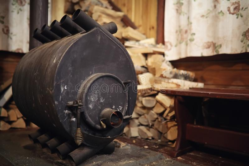 Wood burning stove. Firewood for furnace heating. Warehouse for royalty free stock image